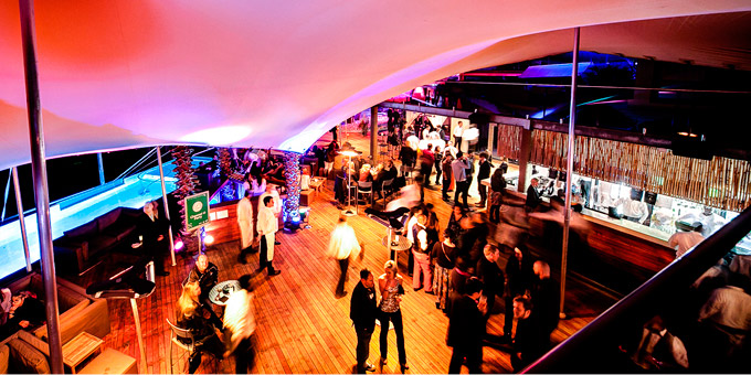 Freeform <sup>®</sup> tents create an electric atmosphere Shimmey Beach Bar Loeries event.